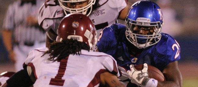 Kansas running back James Sims looks to make a move against New Mexico State defensive back Jonte Green during the fourth quarter Saturday, Sept. 25, 2010 at Kivisto Field.