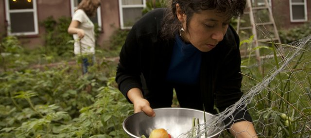 Farb harvests her garden with her youngest daughter Samantha, 12, at her Lecompton home.