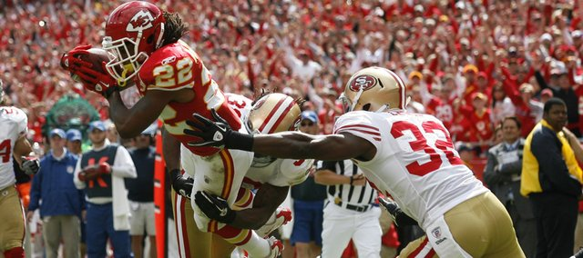 Kansas City Chiefs wide receiver Dexter McCluster (22) dives for a touchdown past San Francisco 49ers safety Dashon Goldson (38), cornerback Shawntae Spencer (36) and safety Michael Lewis (32). The Chiefs beat the 49ers, 31-10, Sunday in Kansas City, Mo.