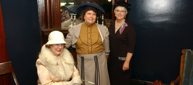In costume and in character, First City Performers and StoryTellers Keyta Kelly, Laura Elkins and Kathy Peak pose inside the Myers Hotel. The three women will portray Leavenworth County historical figures Hilda Clark, Carrie Hall and Mollie Myers  on Tuesday in Tonganoxie.