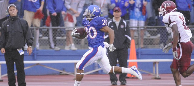 Kansas University kick returner D.J. Beshears (20) is cheered on by the student section as he breaks free for a 96-yard touchdown return in this 2010 file photo. Beshears is listed as a preseason third-team All-Big 12 selection by analyst Phil Steele.