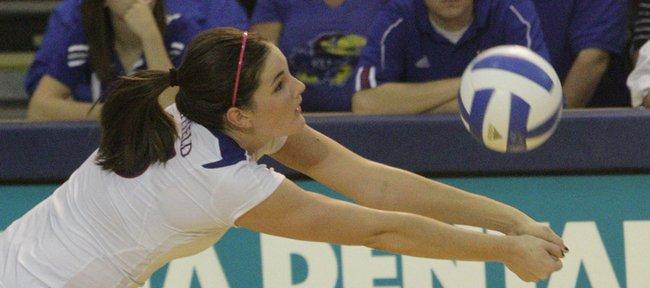 Kansas University's Allison Mayfield (15) stretches for a return against Missouri.