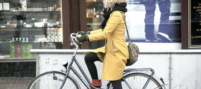 """Amsterdam Yellow Muntplein Bike Girl"" by Gary Mark Smith."