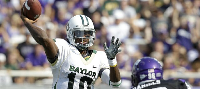 Baylor quarterback Robert Griffin III (10) gets off a pass under pressure from TCU end Zac Scotton during their game Sept. 18 in Fort Worth, Texas. Griffin is as dangerous with his legs as he is with his arms, as players at Kansas University — today's opponent — know well.