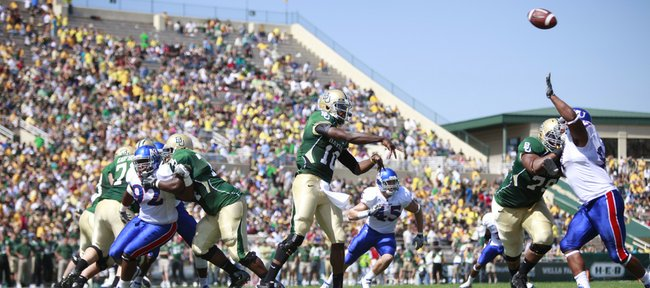 Baylor quarterback Robert Griffin III throws over the Kansas pass rush to the flat during the second quarter Saturday, Oct. 2, 2010 at Floyd Casey Stadium in Waco. The pass was caught by Baylor receiver Josh Gordon and ran for a 94-yard touchdown.