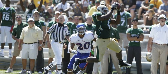 Kansas receiver D.J. Beshears watches as Baylor linebacker Elliot Coffey picks off Kansas quarterback Jordan Webb's pass during the third quarter Saturday, Oct. 2, 2010 at Floyd Casey Stadium in Waco.