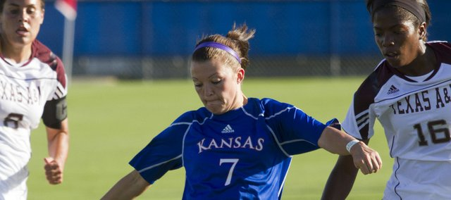 Kansas' Whitney Berry (7) attempts a shot between two Texas A&M defenders Friday afternoon at the Jayhawk Soccer Complex. The Jayhawks lost,1-0.