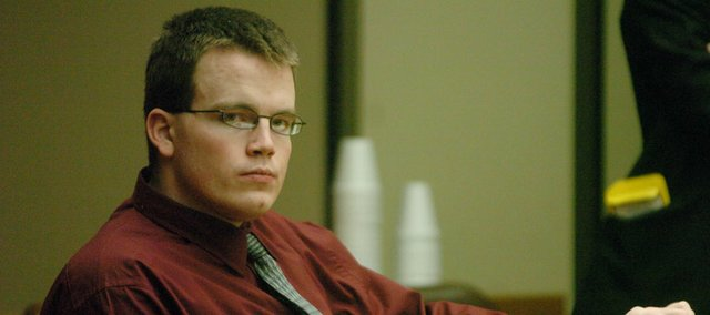 Jason Rose stares at the media during court proceedings. Rose was sentenced in June 2007 to 10 years in prison for setting a fire at Boardwalk Apartments in October 2005. The fire killed three people and injured many.