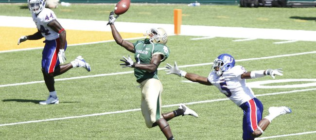 Kansas cornerback Greg Brown tails Baylor receiver Kendall Wright as he reaches for a deep pass during the second quarter Saturday, Oct. 2, 2010 at Floyd Casey Stadium in Waco.