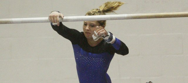 Free State gymnast Kelcy Bowers performs her routine on the bars at the Lawrence All-Around Invitational. Bowers finished eighth in the all-around Monday at Lawrence High.