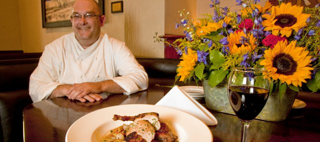 Executive chef Chris Wofford, of Ten restaurant in the Eldridge Hotel, 701 Mass., shows off a fall dish of pheasant and fingerling potato stew.