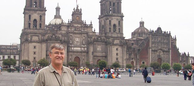 The Rev. Gary Teske stands in the Plaza of Mexico City with the National Cathedral behind him.