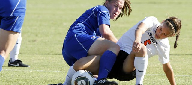 Kansas University's Erin Ellefson gets tangled up with Oklahoma State's Keydall Tredwell. OSU clipped the Jayhawks, 2-0, on Friday at the Jayhawk Soccer Complex.