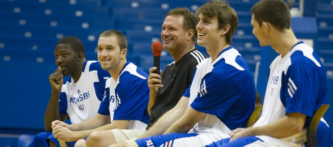 Kansas University men's basketball coach Bill Self, center, and the KU seniors, from left, Mario Little, Brady Morningstar, Conner Teahan and Tyrel Reed, laugh after Self answered a question during a Q&A session Sunday at Allen Fieldhouse.