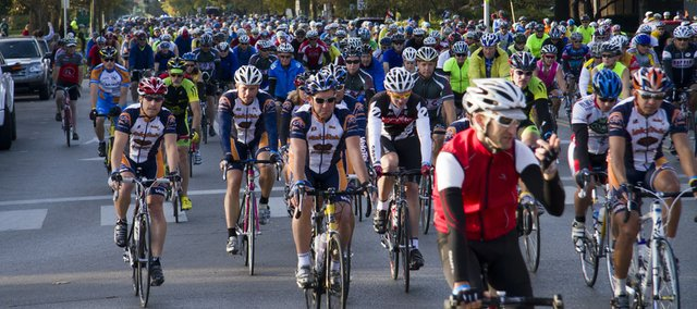 Hundreds of riders take off Sunday morning down Massachusetts Street for the start of the Octoginta bicycle ride in 2010. This year's event will be Oct. 9.