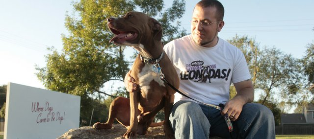 Anthony Barnett, Lawrence, has a three-legged pit bull named Leonidas that he uses for educational purposes to show that all dogs can thrive and be loving in a positive environment.