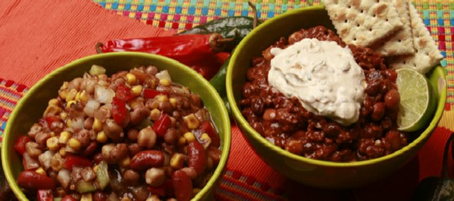 It's chili season and that means breaking out the slow cooker or soup pot and getting to work on some hardy stew. Here, we have grandma's slow cooker vegetarian chili on the left and four-bean chili with chipotle cream on the right.