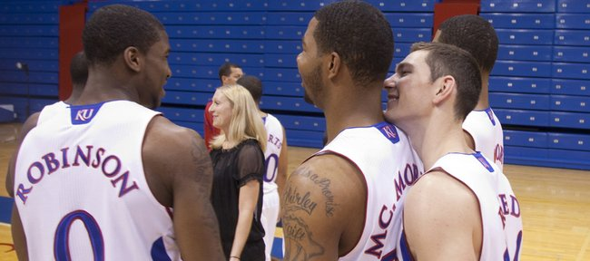 Kansas guard Tyrel Reed jokingly breathes down the neck of forward Marcus Morris as the two and forward Thomas Robinson have fun during media day onTuesday, Oct. 12, 2010 at Allen Fieldhouse.