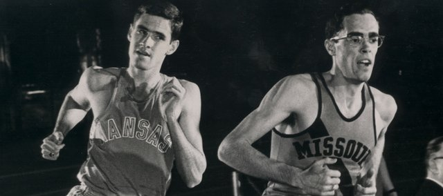 Kansas runner Jim Ryun, left, attempts to pass Missouri's Glenn Ogden in this file photo. Ryun was the first high schooler to run a sub-four-minute mile. The distance isn't run often at the high school level anymore.