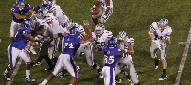 Kansas State quarterback Carson Coffman throws over the Kansas defense in Jayhawk territory during the first quarter, Thursday, Oct. 14, 2010 at Kivisto Field.