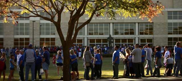 Basketball fans line the sidewalk along Naismith Drive as they wait for Allen Fieldhouse to open prior to the start of Late Night in the Phog, Friday, Oct. 15, 2010.