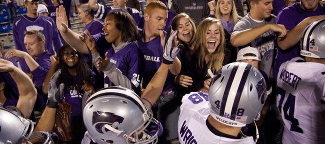 Kansas State fans celebrate with the Wildcats after their 59-7 win over Kansas, Thursday, Oct. 14, 2010 at Kivisto Field.