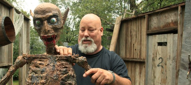 As Halloween approaches, some people go all out for the ghoulish holiday, like Dana Dyer, who lives at 1755 E. 1310 Road in northwest Lawrence. For 13 years, his yard been scaring the wits out of friends and on lookers. The set up process takes up to 2 months for the right effects.