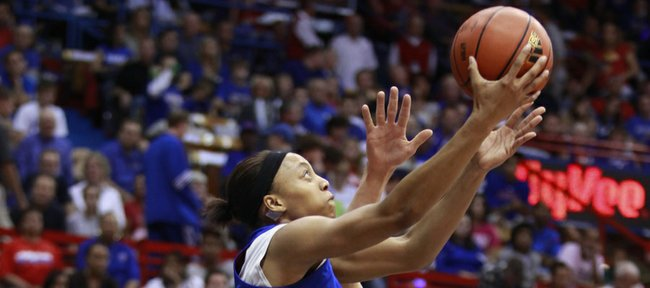 Kansas forward Aishah Sutherland goes to the hoop against a defender during Late Night in the Phog, Friday, Oct. 15, 2010.