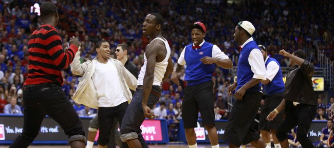 The Kansas basketball team comes together in costume for a final dance before their introductions during Late Night in the Phog, Friday, Oct. 15, 2010.