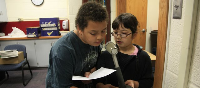 Jaiden Younger and Dana Rath, both fifth-graders at Cordley School, read the morning announcements on Friday.  This task is usually done by sixth-graders, but fifth-graders are also getting a chance to make announcements since they will not be at the elementary school next year when middle schools replace junior highs.