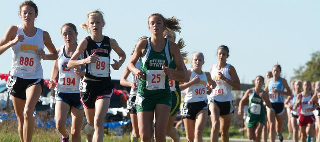 Lawrence sophomore Grace Morgan (89) and Free State junior Lynn Robinson (25) run in the lead pack at the one-mile mark Saturday at Sunflower League championships at Rim Rock.