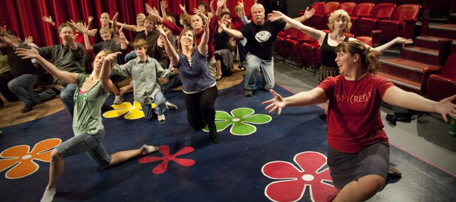 Aspiring actors and actresses run through dance routines with choreographer Melia Stockham, bottom right, during tryouts for Annie on Wednesday at Theatre Lawrence, 1501 N.Y. The theater recently received a nearly $500,000 grant from the Mabee Foundation of Tulsa, Okla.