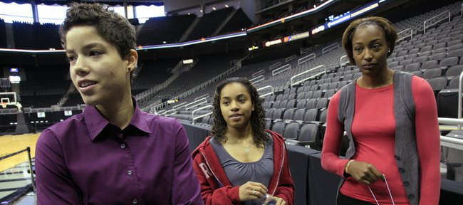 Kansas University women's basketball players, from left, Monica Engelman, Angel Goodrich, and Carolyn Davis get ready to answer questions at Big 12 Media Day on Wednesday at Sprint Center in Kansas City, Mo. Injuries to experienced KU players forced the trio into early action last season. This year, they are ready to take on leadership roles.