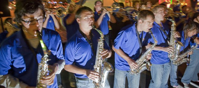 The Jayhawk Band rocks Massachusetts Street during a pep rally Thursday, Oct. 21, 2010, for Kansas University's homecoming game this Saturday against Texas A&M. Kansas Athletics, the Lawrence Chamber of Commerce and several other groups were involved in the rally on the 1000 block of Massachusetts Street.