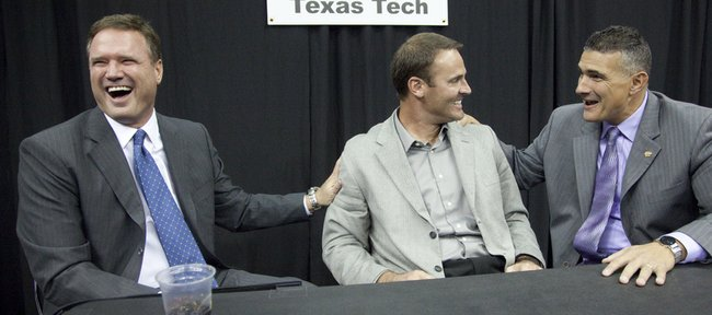 Kansas head coach Bill Self laughs as he sits down for a chat with Texas Tech head coach Pat Knight and Kansas State coach Frank Martin following talks with reporters during Big 12 media day Thursday, Oct. 21, 2010 at the Sprint Center in Kansas City, Mo.