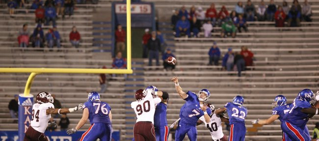 Kansas backup quarterback Kale Pick throws an incomplete pass before the backdrop of sparsely populated seats during the fourth quarter Saturday, Oct. 23, 2010 at Kivisto Field.