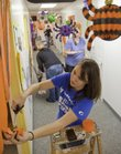 Misty Powelson a KU junior participates in Make a Difference Day, Saturday, October 23, 2010, decorating Stepping Stones Day Care, 1100 Wakarusa Dr. with a touch of Halloween. Volunteers in the community participated in Make a Difference Day by working on several area projects.