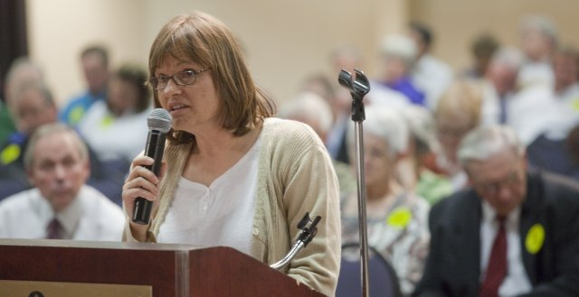 Karin Pagel-Meiners, Lawrence, speaks during public comment hearing on the proposal for an 895-megawatt coal-burning power plant in southwest Kansas. The hearing was held Monday at the Capitol Plaza Hotel in Topeka.