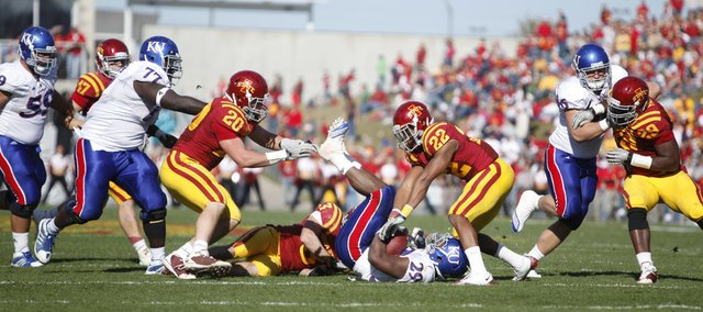 The Iowa State defense drags down Kansas running back James Sims late in the second quarter Saturday, Oct. 30, 2010 at Jack Trice Stadium.