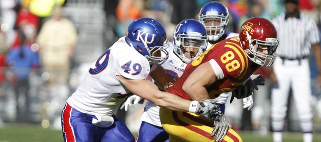Kansas linebacker Drew Dudley drags down Iowa State tight end Collin Franklin after a reception during the third quarter Saturday, Oct. 30, 2010 at Jack Trice Stadium.