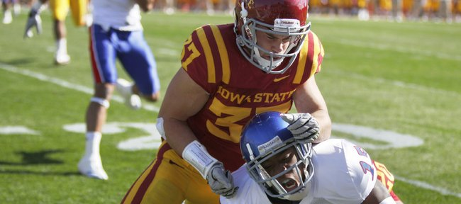 Iowa State defensive back Michael O'Connell stops Kansas receiver Daymond Patterson short of a first down during the first quarter Saturday, Oct. 30, 2010 at Jack Trice Stadium.