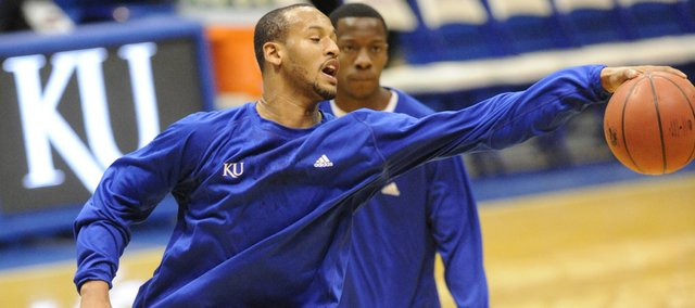 Kansas guard/forward Travis Releford snags a loose ball during warmups before the Jayhawks' game against Baylor on Jan. 20 in Allen Fieldhouse. Releford, a sophomore from Kansas City, Mo., red-shirted last season.