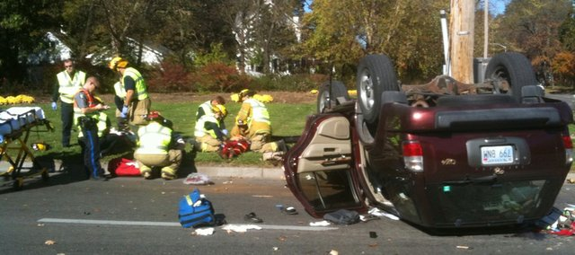 Emergency crews tend to patients at the scene of a car accident on 23rd and Massachusetts streets on Wednesday, Nov. 3, 2010.