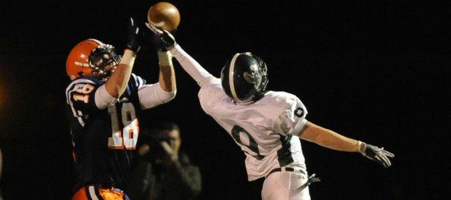 Free State's Tucker Fritzel (9) knocks down a pass intended for Olathe East's Brent Guiser (18).