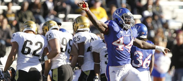 Kansas safety Olaitan Oguntodu signals Jayhawks' ball as the Colorado special teams unit huddles over the pile following an onside kick by KU during the fourth quarter, Saturday, Nov. 6, 2010 at Kivisto Field.