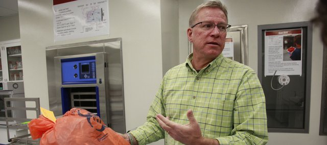 Scott Rusk, director of the Biosecurity Research Institute in Manhattan, explains how biological waste is disposed. Scientists are working on some dangerous biological diseases that could be spread through animals or food supplies. The lab is located at the north end of the Kansas State University campus.