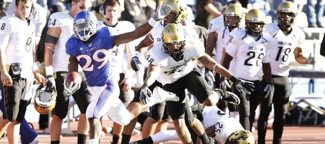 Colorado linebacker Liloa Nobriga pushes Kansas running back James Sims out of bounds during the fourth quarter, Saturday, Nov. 6, 2010 at Kivisto Field.