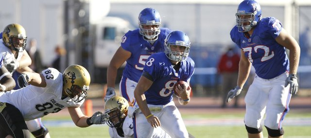 Kansas quarterback Quinn Mecham (8) runs through a hole in the Colorado defense during the fourth quarter of the Jayhawks' 52-45 victory Saturday at Memorial Stadium.