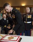 Major William Seelmann, Marines officer instructor at Kansas University, uses a sword to the cut a cake commemorating the 235th birthday of the U.S. Marine Corps, Wednesday, Nov. 10, 2010 at the Dole Institute of Politics.