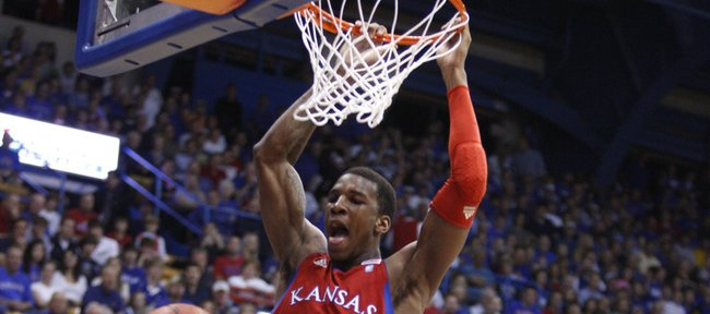 Kansas forward Thomas Robinson delivers a put-back dunk over Emporia State guard Robert Moores during the first half, Tuesday, Nov. 9, 2010 at Allen Fieldhouse.